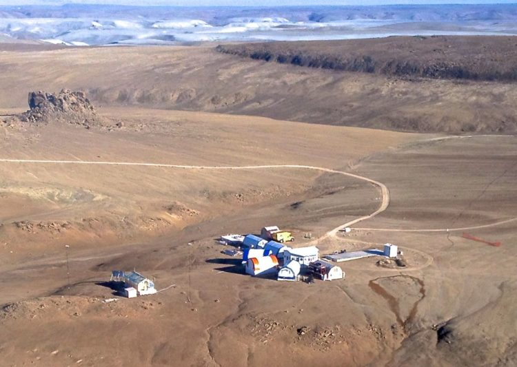 The Haughton crater on Canada's Devon Island, which is so other-worldly, scientists (pictured) have set up camp there to conduct Mars-related research
