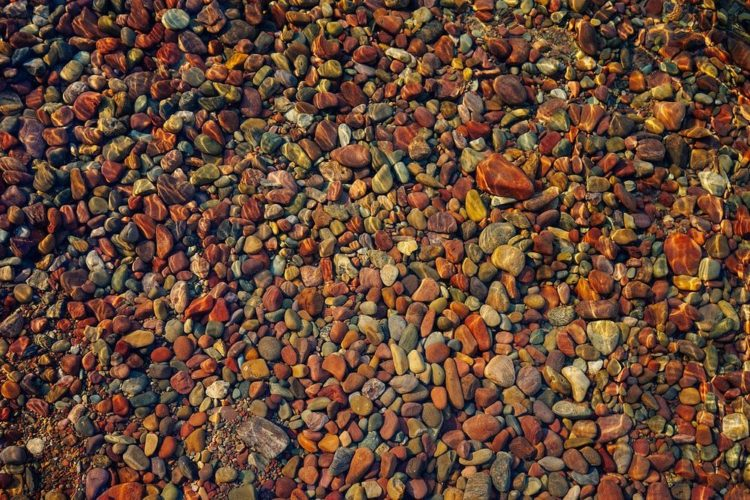 These natural rocks are actually all around Glacier National Park, and were created at different eras. Because, when the glaciers came, it broke down the rocks into miniature fragments and the rivers washed them away.