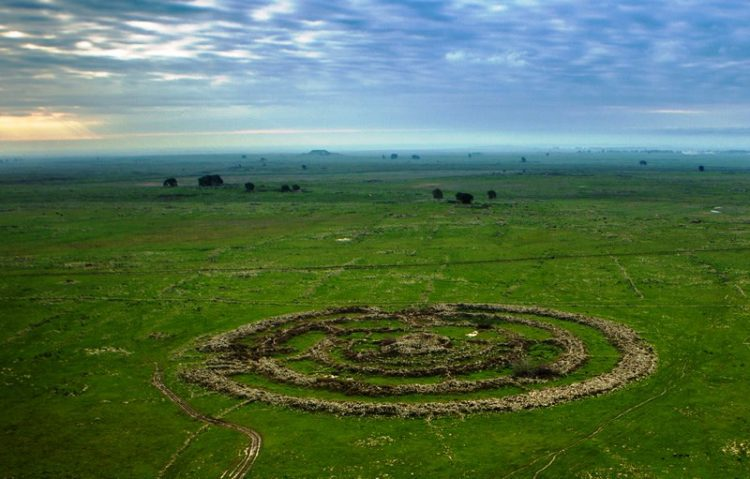 """This is also called Rujm el-Hiri (means """"stone heap of the wild cat) is dated to about 3000 BC, which makes it contemporary to famous England's Stonehenge."""
