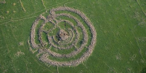 the ancient megalith monument, comprising of concentric stone circles and a tumulus at the center.