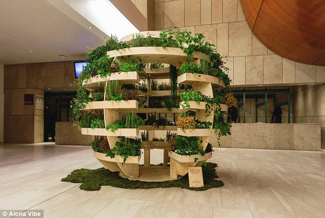 """Growroom"" is a 9ft high piece of living furniture for growing plants, vegetables, Bonsai and herbs; it is made of just 17 sheets of plywood."