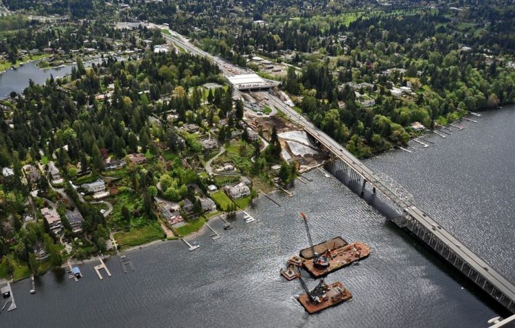 Aerial view of Evergreen Point Road, Eastside staging area and floating bridge construction barges. Photo credit Washington State Dept of Transportation @ Flickr