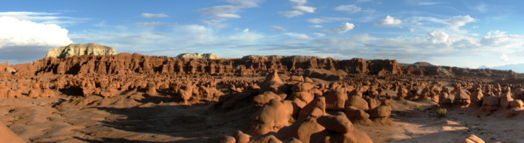 The Chaffin and his friends were awed by what they saw five buttes and a valley of strange, goblin-shaped rock formations fenced by a wall of eroded cliffs.