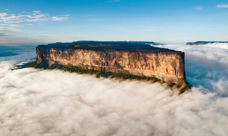 Once impenetrable to all but the Pemon indigenous people, thousands of hikers a year now make the trek across savannah, through rivers, under a waterfall and along a narrow path scaling the cliffs of Mount Roraima.