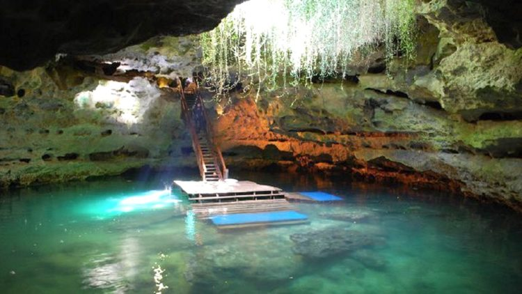 """The cave shape is described as an """"inverted mushroom"""" where water level expands up to 200 feet across. Thus, the water level in the cave has fallen along with the water table in the area."""