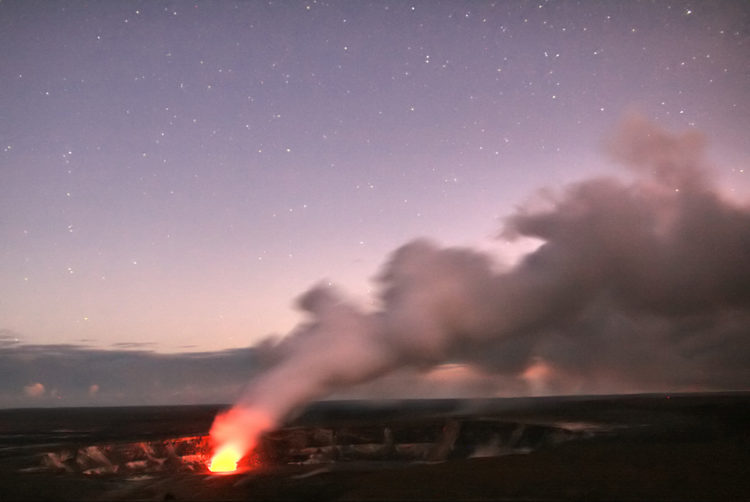 At night, an incandescent glow illuminates the venting gas plume