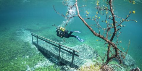 This picture shows scuba diver Marc Henauer exploring the beautiful Green Lake in Tragoess, Austria, which floods every year