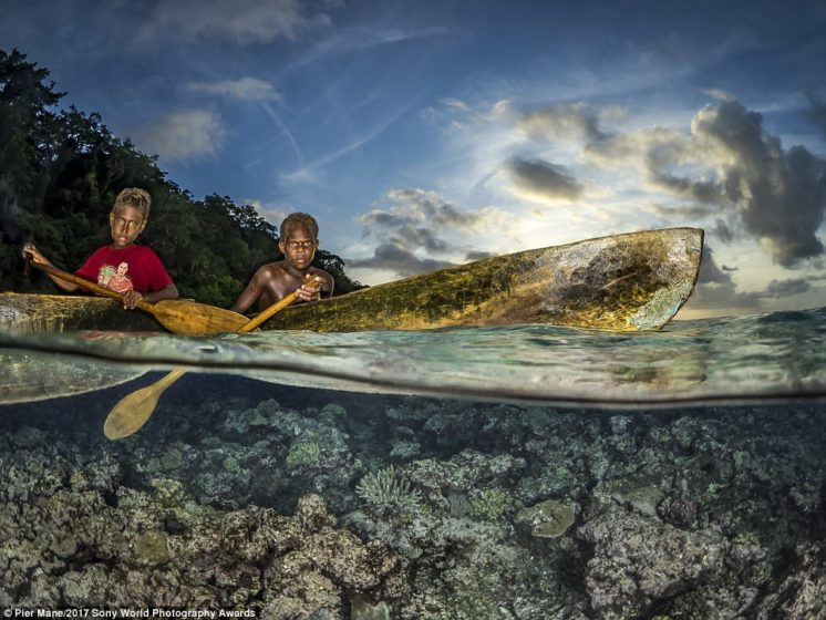 Pier Mane captured this indigenous tribe of the Solomon islands, where he says: 'It seems kids learn to paddle before they walk'