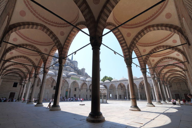 The mosque is surrounded by a continuous vaulted arcade and having ablution facilities on both sides.