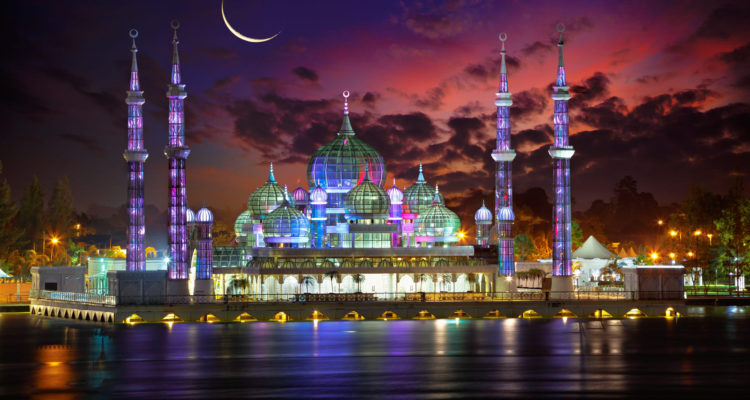 A large crystal chandelier forms the main prayer hall's centerpiece. At night, the mosque comes alive with a mesmerizing display of lights, which changes the color of its domes and minarets to pink, green, yellow and blue.