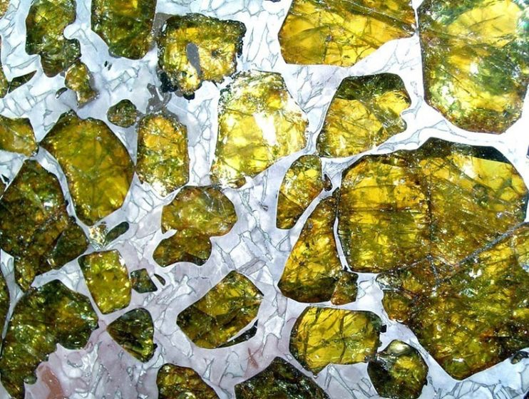 It is a pallasite, a type of meteorite with translucent golden crystals of a mineral called olivine embedded in a silvery honeycomb of nickel-iron.