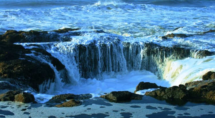 Thor's Well is located in the Cape Perpetua Scenic Area, just three miles south of Yachats, a natural bowl-shaped hole carved out of the rough basalt shoreline.