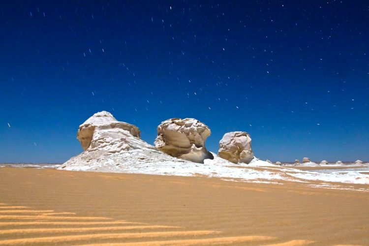 . The limestone bases had been worn away by the mixture of wind and sand that had blown by them at high speeds for thousands of years.