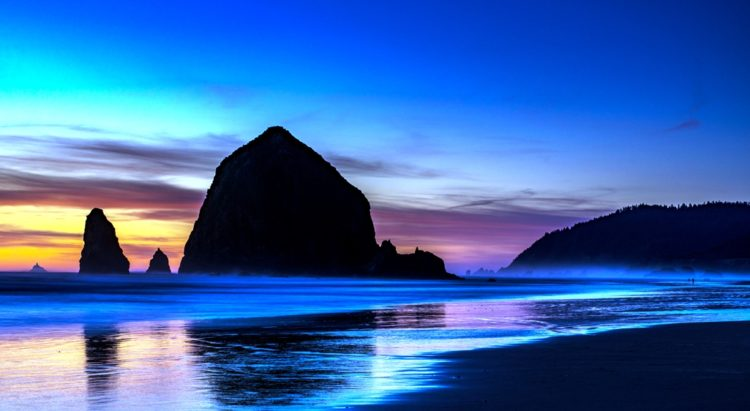 """Haystack Rock is a 235-foot sea stack in Cannon Beach, Oregon. It is sometimes claimed locally to be the third-tallest such """"intertidal"""" structure in the world, but they're are no official references to support this."""