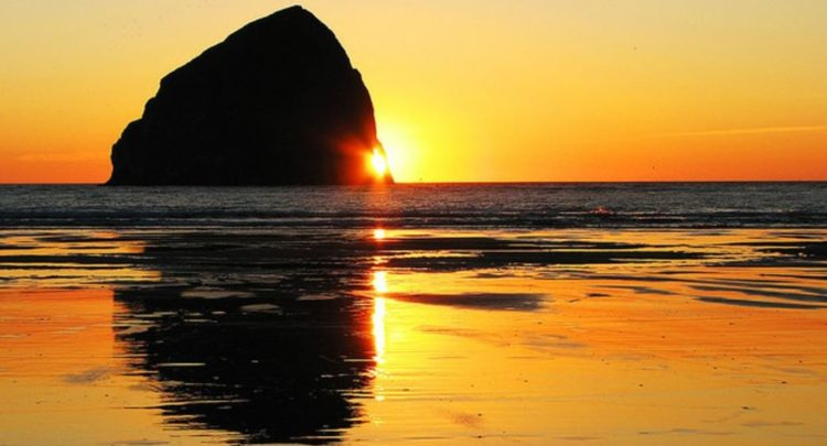 Haystack rock is composed of basalt, formed by lava flows emanating from the Blue Mountains and Columbia basin about 15 million years ago.