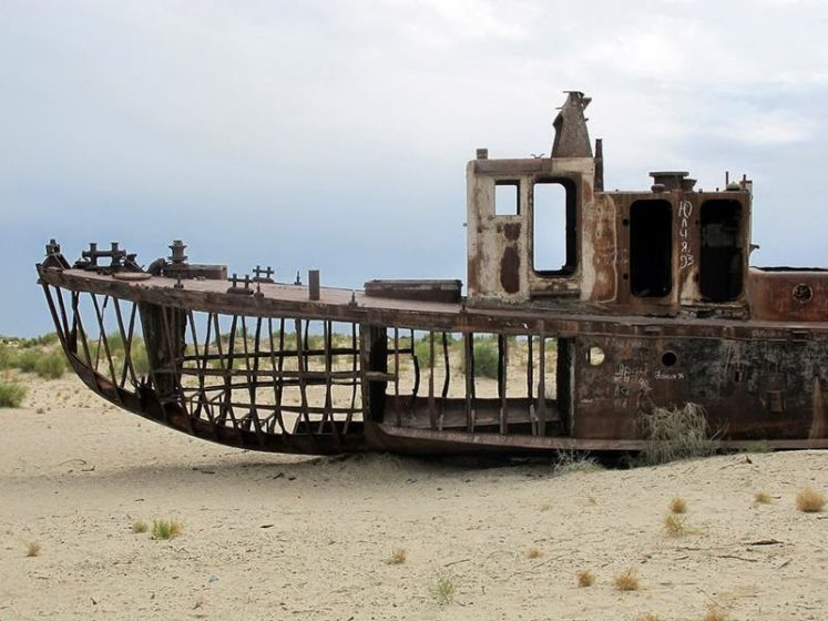 In Uzbekistan, an eerie ship graveyard filled with hauntingly beautiful shipwrecks beckons, is literally a ghost town in the middle of the desert.  Image credit Globespotter