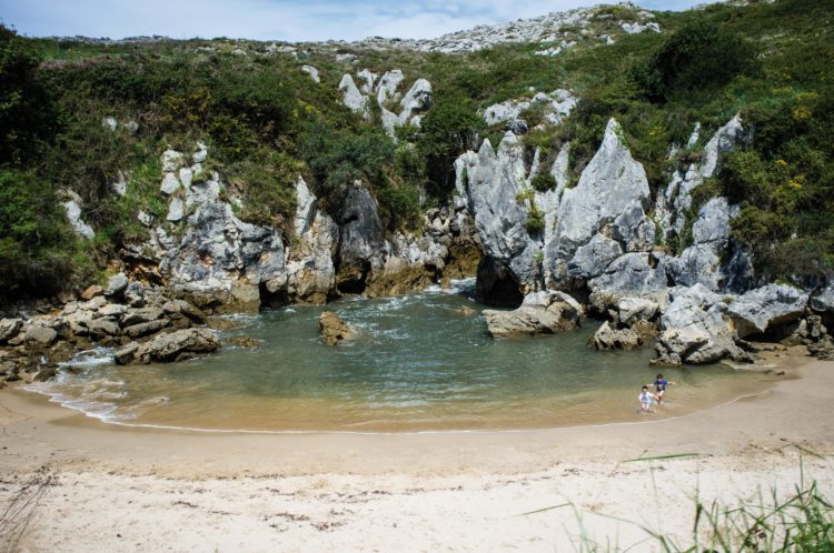 Playa de Gulpiyuri is one of the most astonishing beaches in the world, tucked away into a small inland hollow.