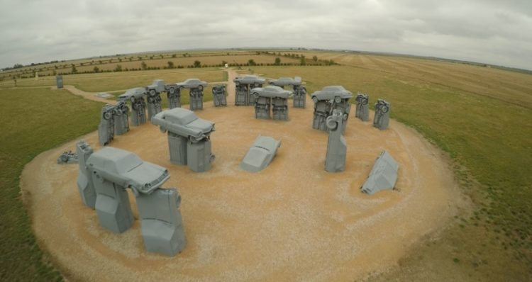 As you know, that original Stonehenge is built with large standing stones, but Carhenge is built from vintage American automobile, but all covered with gray spray paint.