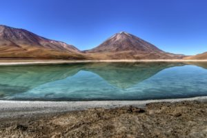 It has mineral suspensions of arsenic and other minerals which renders color to the lake waters.