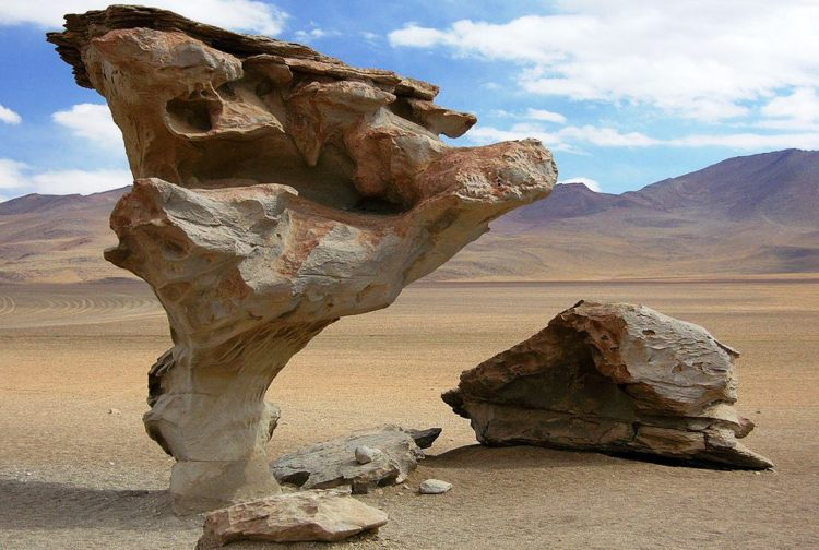 Much looking like wind, sand, and water can sculpt out of the earth! This particular Bolivian reserve and arid, stark desert horizon coupled with strange rock formations strike a strong resemblance to the famous surrealist's work.