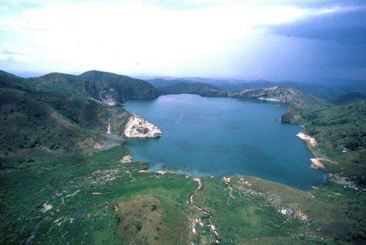 Scientists still don't know what triggered the misery Lake Nyos in northwestern Cameroon a large cloud of carbon dioxide formed, rose at nearly 100 kilometers per hour, and spilled over the northern lip of the lake.