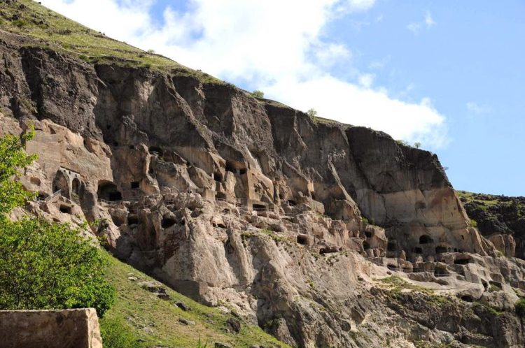 The remnants of the terrace walls on the top of the mountain, where the mountain simply sheared off and simply dropped to the ground below, exposing the monastery within.