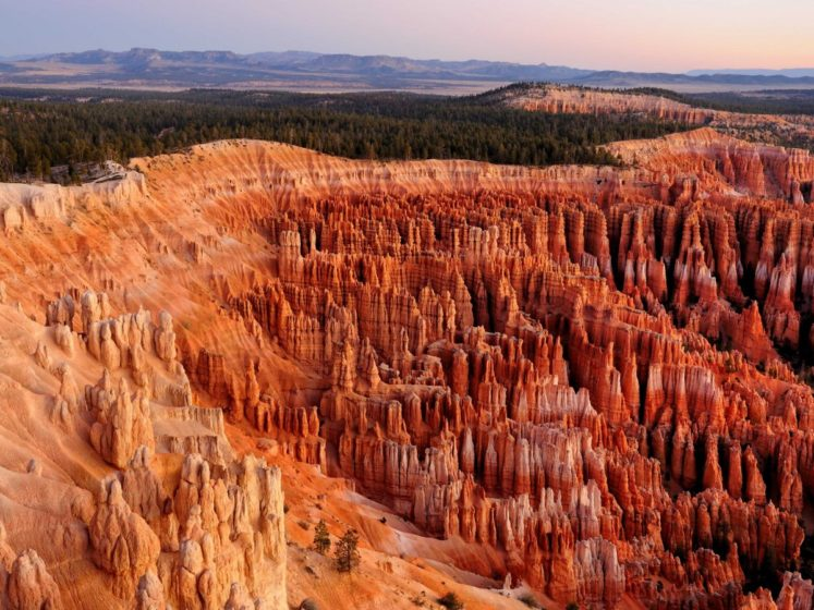 Bryce Canyon in southwestern Utah is home to brightly colored geological structures called hoodoos, formed by frost, weathering, and erosion.