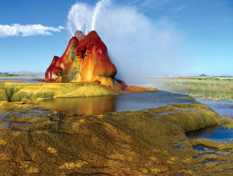 Fly Geyser is less famous tourist attraction that was accidentally created in 1916 during a well drilling, Water heated by geothermal energy creating the multi-colored mount.