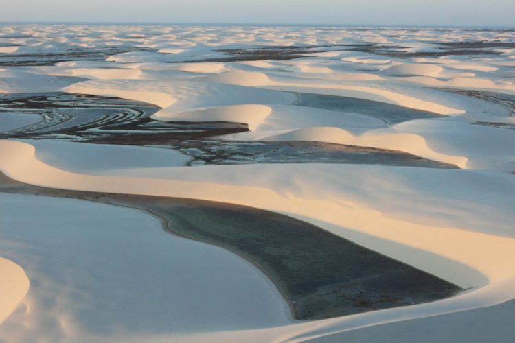 Lencois Maranhenses Sand Dunes of Brazil look like average sand dunes, and valleys are filled with water since the low-lying lands often flood during the wet season.