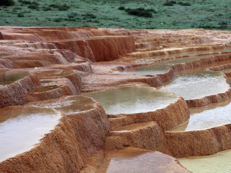 Naturally formed staircase Badab-e Surt, 2 mineral hot springs deposited carbonate minerals on the mountain, leaving behind pools of water and naturally-formed steps.