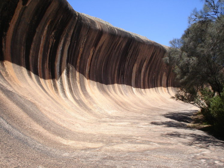 Wave Rock name derives from the fact that it is shaped like a tall breaking ocean wave, composed of granite and the total outcrop covers several hectares.