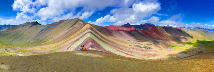 The mountain is striped with colors ranging from turquoise to lavender to maroon and gold.
