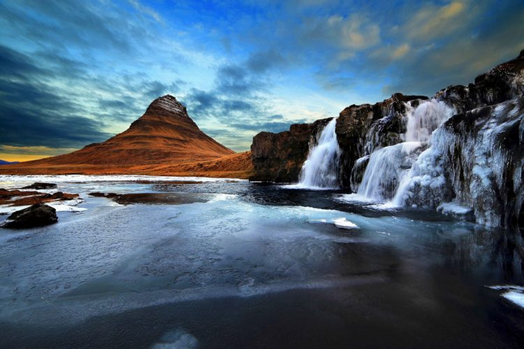 The mountain of Kirkjufell and its waterfall Kirkjufellsfoss, attracts nature lovers and photographers.