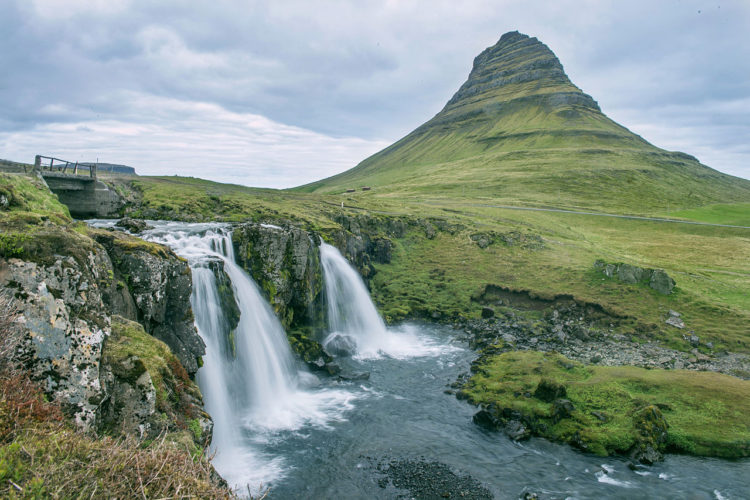 There's something exclusive about the shape of Mt. Kirkjufell, green in summer, orange in winter and white with snow.