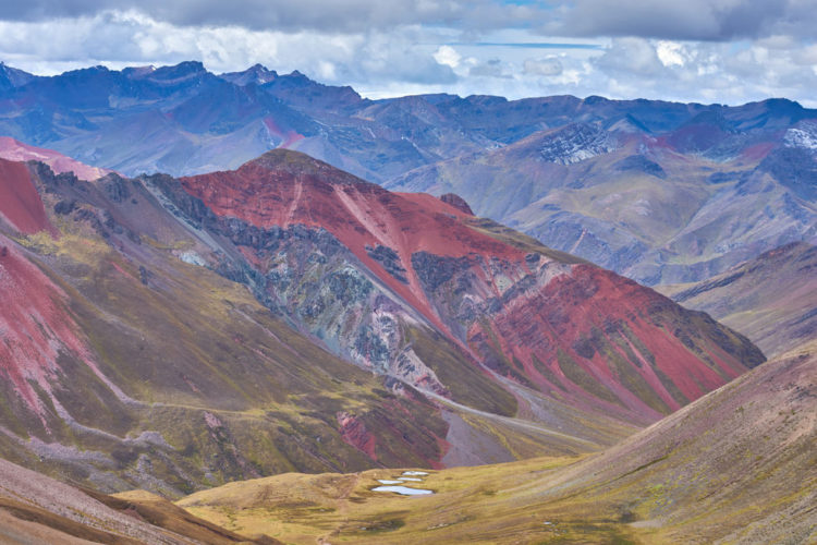 Rainbow Mountain is a colorful mountainside in the Andes of Peru. In short, the colors you see were formed by sedimentary mineral layers in the mountain that have been exposed by erosion.
