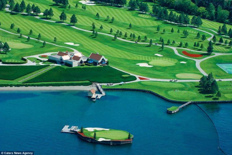 The 14th green at the Coeur d'Alene golf resort in Idaho, which is on a man-made island that floats in the middle of the lake