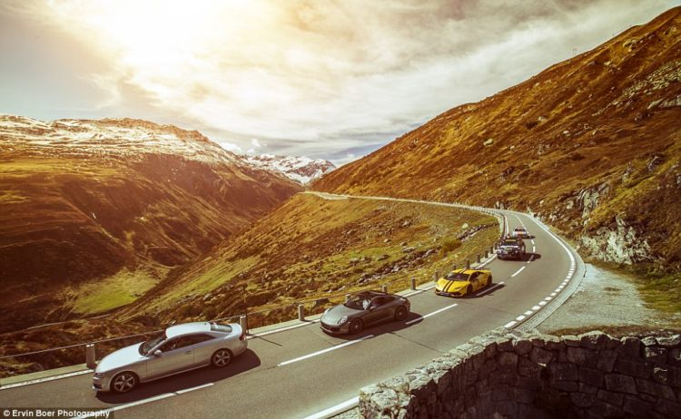 The cars travel in convoy just after travelling over the Furka Pass, which links the Swiss Alps with the towns of Gletsch, Valais and Realp