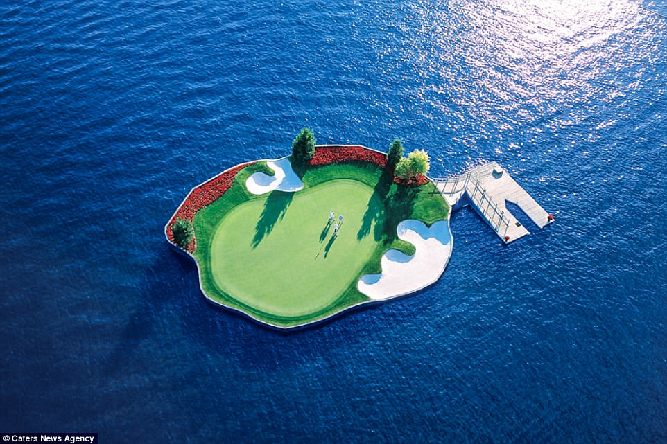 The famous 14th hole, pictured, is 'one of the most unique and recognisable golf holes in the world' according to the resort