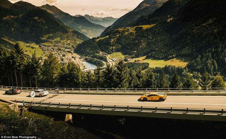 The group of cars on the rally trip head down the Gotthard Pass in Switzerland.