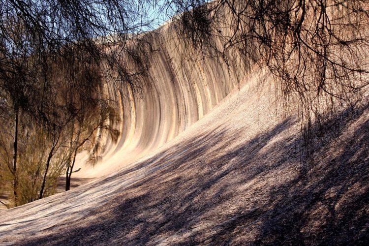 Wave Rock is 27 million years old and made up of grey and red granite strips, is quite a formation aboriginal rock paintings can also be seen at nearby Bates Cave.