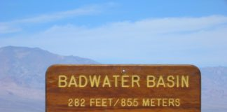The salt flats are hazardous to traverse to the sign marking the low point is at the pool instead.