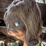 Terrified by the spirit, he started collecting dolls. He would find in the canal, from heaps of trash and hundreds of toys. Then some missing body parts from the trees and the wire fencing which surrounded his wooden shack.