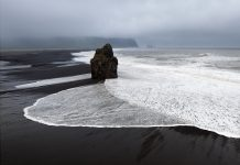 Reynisfjara Black Sand Beach is hands down the coolest with it's black sand, insane basalt columns, lava formations