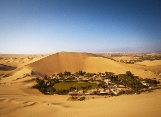 Huacachina village is located in the desert of southwestern Peru. Actually, it's a small oasis with the modest population of a hundred or so permanent resident,