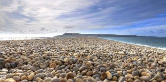 """The English Chesil Beach """"Chesil Bank""""lies in the county of Dorset. It is popular for its pebbles stretched 18 miles (28 kilometers) long and north-west from Portland to West Bay."""