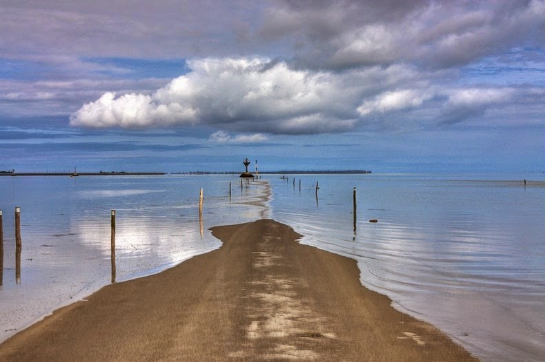 Passage du Gois is submersible causeway in Bay of Bourgneuf, connecting island of Noirmoutier to mainland in department of Vendée in France.