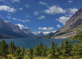 Wild Goose Island lies within Saint Mary Lake in Glacier National Park in the U.S. state of Montana. This is tiny Island of just 4,496 feet and rising a mere 14 ft from the surface of lake water.