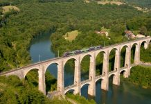 SNCF B 81661 is a spectacular passing scene on the Cize–Bolozon Viaduct which is a road-rail bridge crossing the Ain gorge in France.