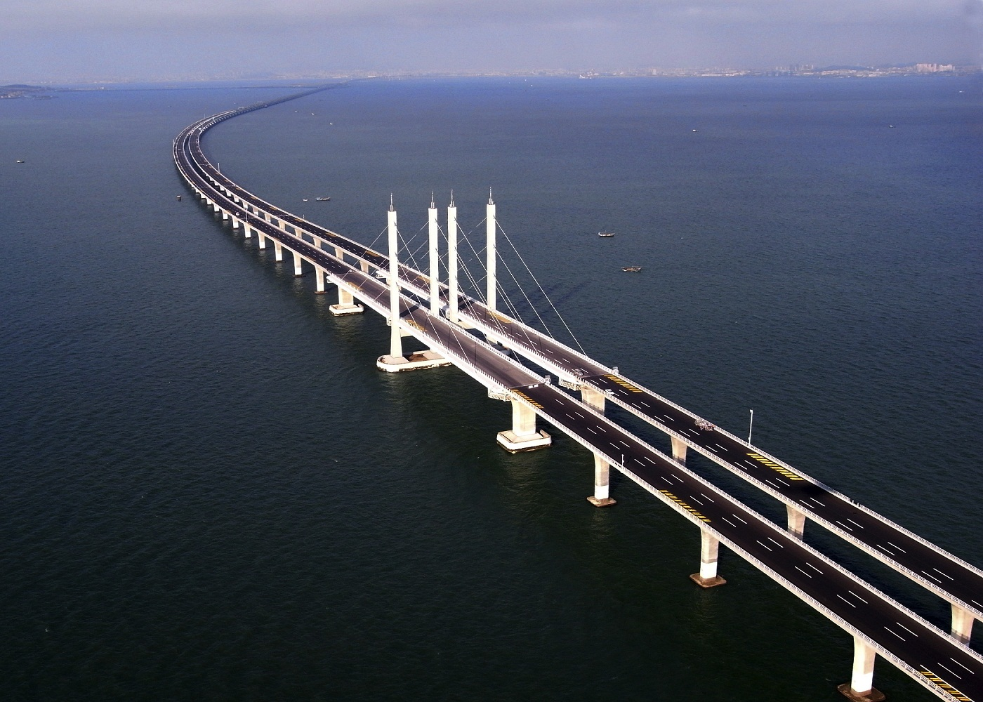The purpose of the bridge as part of the plan to provide better connectivity between the two fast-growing industrial regions on either side of the Jiaozhou Bay.