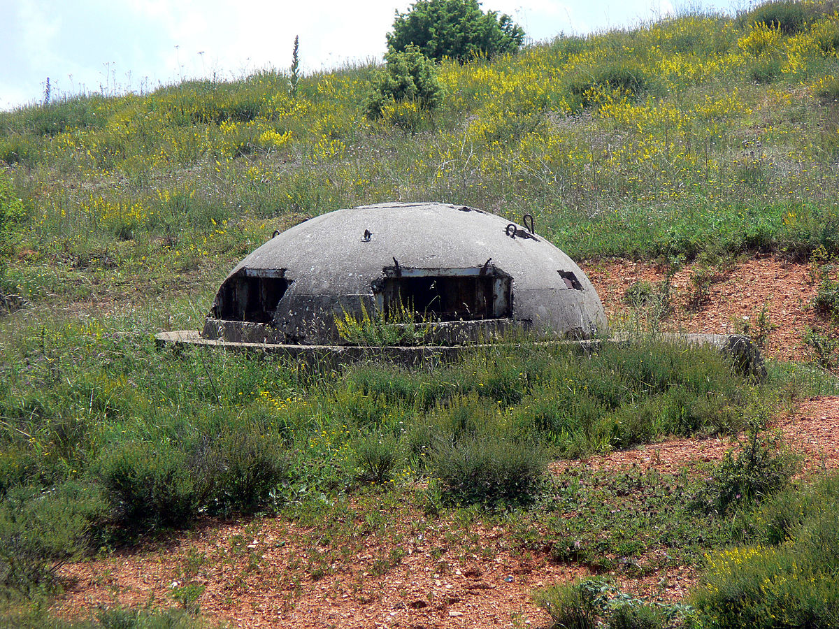 Bunkers in Albania domed concrete roofs and narrow eye slits crouched suggestively on either side of the road to Tirana.